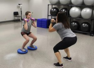 Jen doing weights with a physical therapy patient