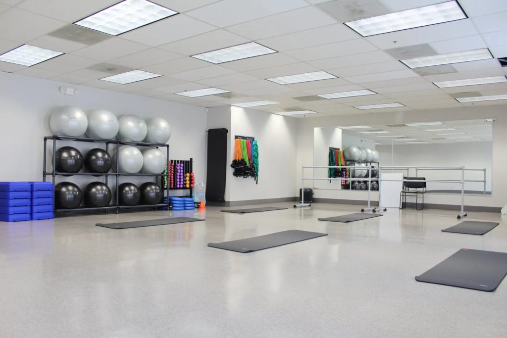 Fitness class room with yoga mats and exercise balls