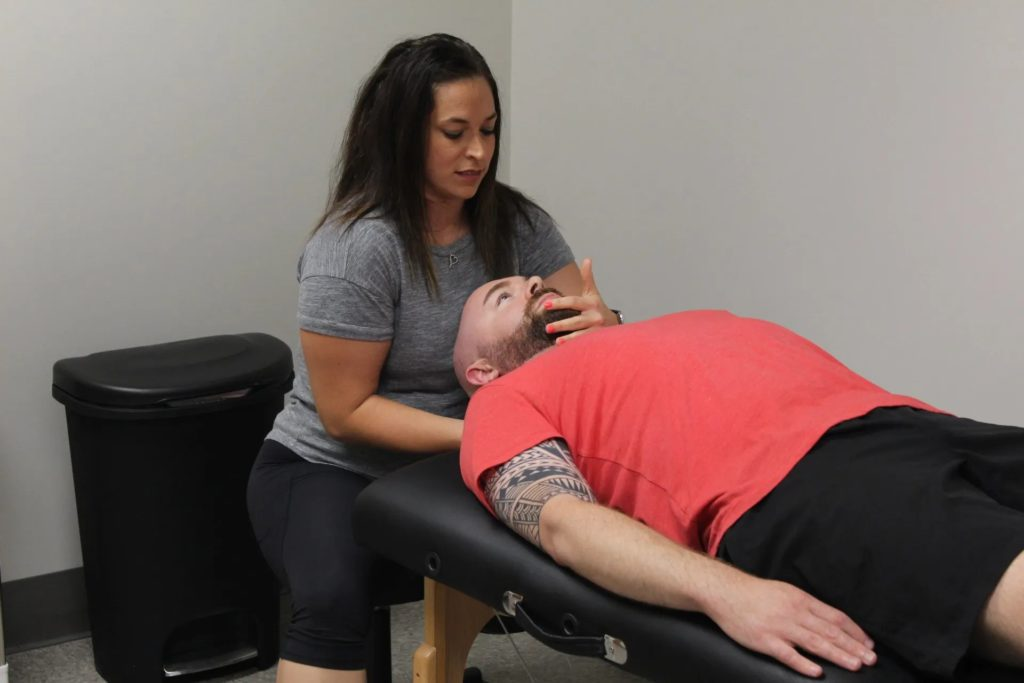 Dr. DeSantis administering physical therapy for neck pain