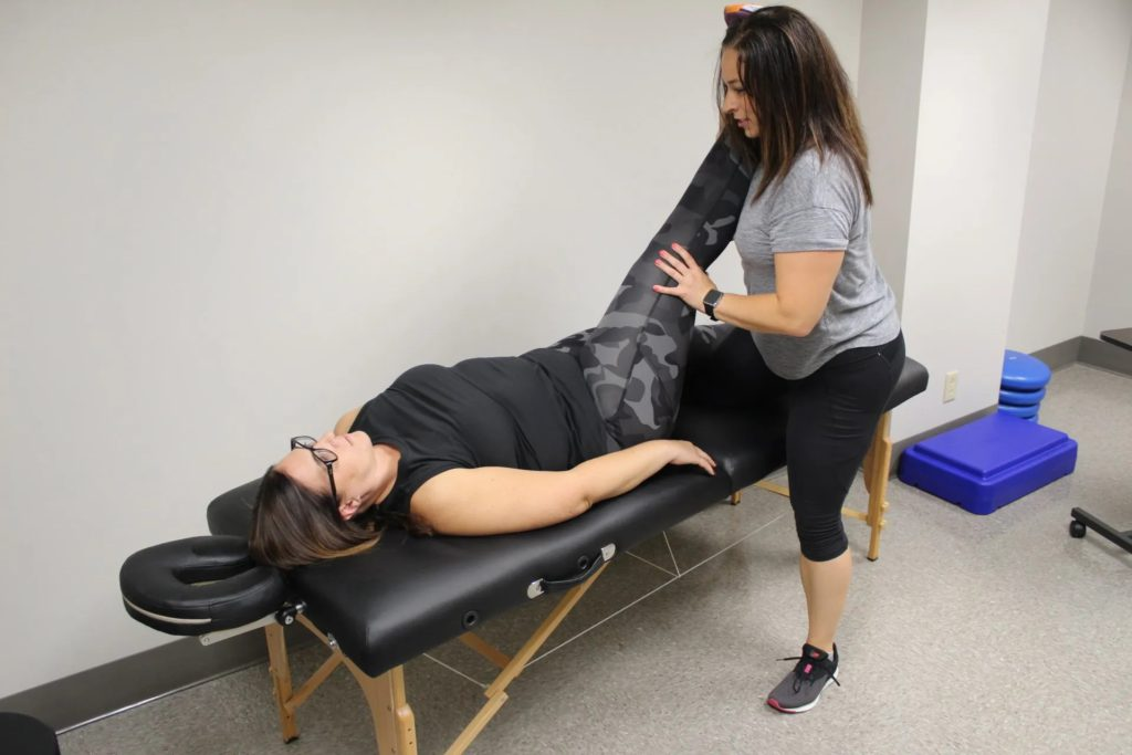 Dr. DeSantis administering physical therapy for knee pain.
