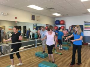 Three people participating in a TherHab Fitness Class